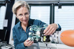 Photo of Aude Billard working with a robotic hand